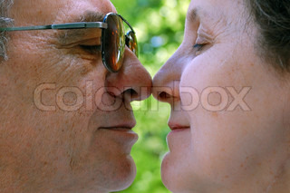 senior man and woman touching noses