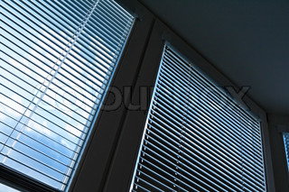 Window blinds for sun protection, heat protection. Sky behind plate