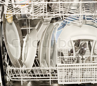 Dishes in the open dishwasher , Inside , clean dishware.