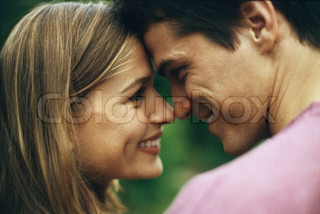 ?John Dowland/AltoPress/Maxppp ; Couple face to face, touching noses and smiling at each other