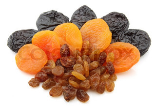 Raisin, dried apricots, prunes on a white background
