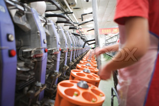 ?James Hardy/AltoPress/Maxppp ; Spooling frames in cotton mill, Guangdong province, China