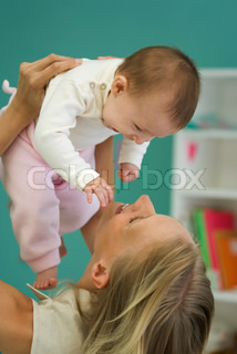 ?Ale Ventura/AltoPress/Maxppp ; Young mother holding up baby, both smiling