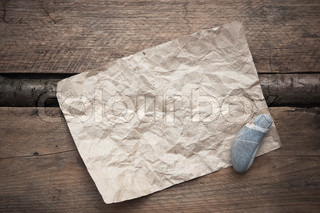scrap of paper on a wooden background