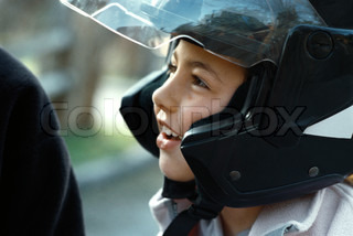 ?Laurence Mouton/AltoPress/Maxppp ; Girl wearing motorcycle helmet