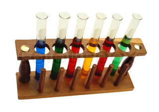 Various glass test tubes in holder isolated on the white background