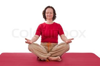 Mature adult woman making yoga exercises - isolated on white