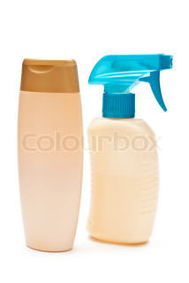 Two blank bottles of shampoo and hair protector products isolated on white