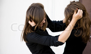 Conflict. Two Teenager Girls Fighting Outdoors.
