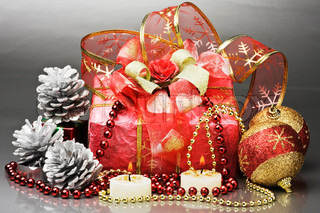 gifts and Christmas decorations on a gray background