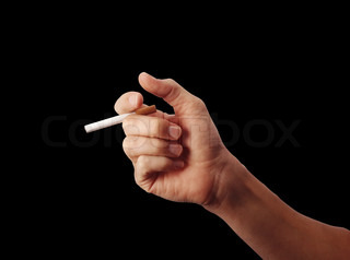 man's hand with a cigarette over black background