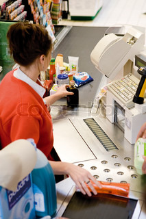?Philippe Dureuil James Hardy/AltoPress/Maxppp ; Cashier scanning purchases at checkout counter