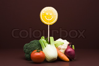 ?Milena Boniek/AltoPress/Maxppp ; Food concept, pile of fresh vegetables with sugarfree lollipop