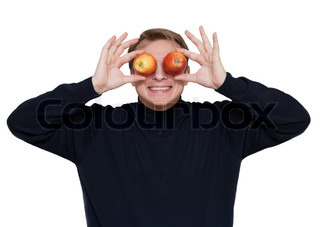 Man with apple on eye on white background