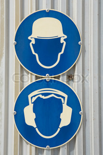 ?James Hardy/AltoPress/Maxppp ; Signs at construction site requiring those on site to wear protective gear