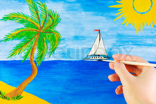 woman's hand draws a beautiful landscape about the sea and the island