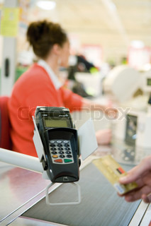 ?Philippe Dureuil Philippe  Dureuil/AltoPress/Maxppp ; Customer making purchase with credit card using card reader
