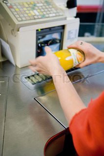?Philippe Dureuil Philippe  Dureuil/AltoPress/Maxppp ; Cashier scanning bottle of juice, cropped