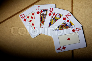 A royal straight flush playing cards poker hand in tambourine. Cards for game in poker. Cards on a table for game in poker. A fan from cards