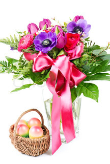 colorful spring flowers bouquet and easter eggs