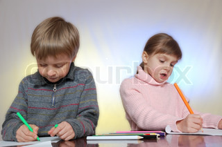 elementary age kids drawing at the desk
