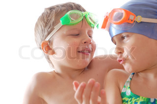 two kids with goggles on their heads talking