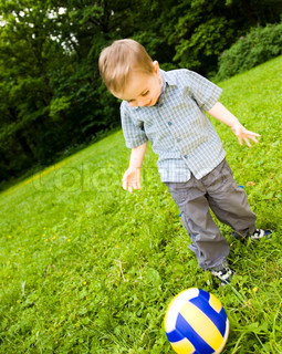 Young Football Player On  The Grass Field