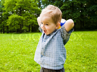 Young Baby Playing With Ball Outdoors