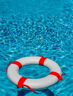An Emergency Tire Floating In A Swimming Pool Symbolic