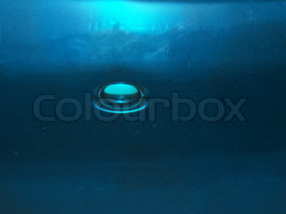 background with blue water bubbles  water; splashing; bubble; blue; liquid; transparent; drop; freshness; nature; abstract; purity; wave; clean; ripple; flowing; color; sea; cold; backgrounds; wet; rippled; nobody; image; pouring; copy; drink; waving; spa