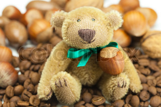 teddy bear with a bow, coffee beans and nuts