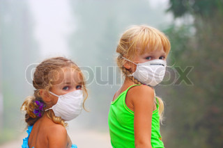 The image of two girls in the masks