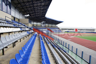 stadium's stands with seats for spectators