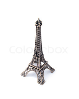 Small  copy of Eiffel tower figurine isolated on white background