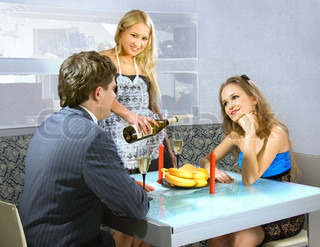 courting couple and blonde waitress in a restaurant