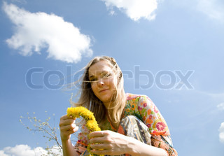 Spring Time. Young Woman With Flowers Under The Cloudscape.