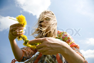 Spring Time. Young Hippie Girl With Flowers Under The Sunlight.