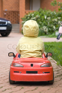 The Child Driving Red Car