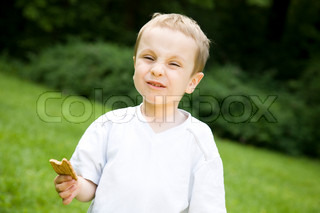 A Little Boy Eating Cookie