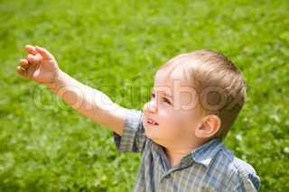 Little Kid Pointing At The Sky
