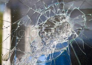 Grey window broken by vandals