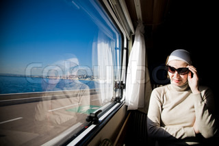 Woman In Motorhome Looking Through Window On The Sea