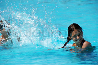 Kids having fun in swimming pool