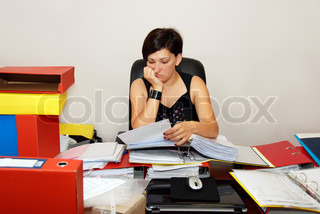 busy woman at the office desk working