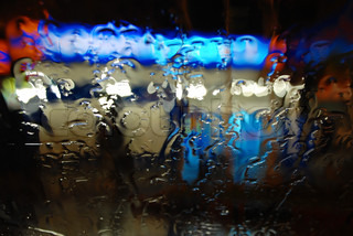 Raindrops on the windshield of the car at night