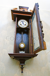 Antique drum head grandfather clock  on a wall