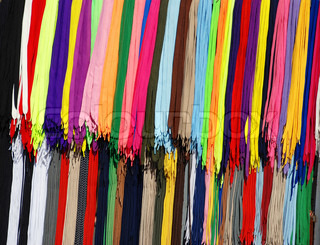multicolored new laces hanging in row on sale