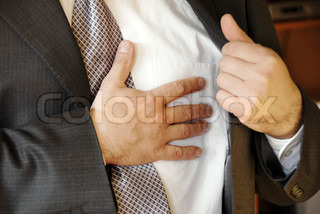 businessman  hand on chest, stressful job troubles