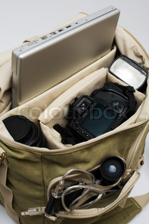 The camera, lens, flash and laptop in a bag