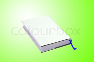 White book over green background